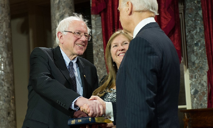 Biden and Sanders shake hands.